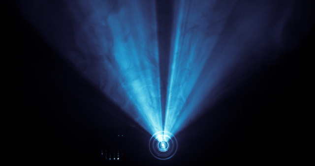 light from a projector that doubles as a visual pun for a vulva