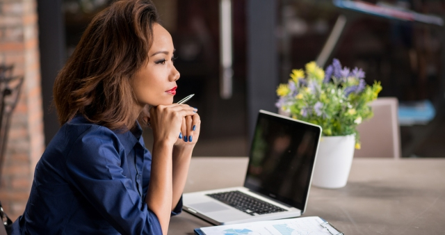 woman (over)thinking at a desk
