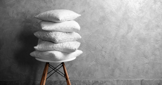 pillows stacked on chair