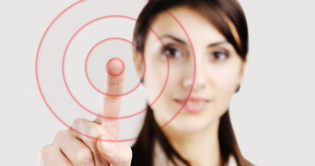 woman hitting target